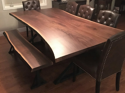 Rescued walnut live edge dining table and matching bench on black metal frames
