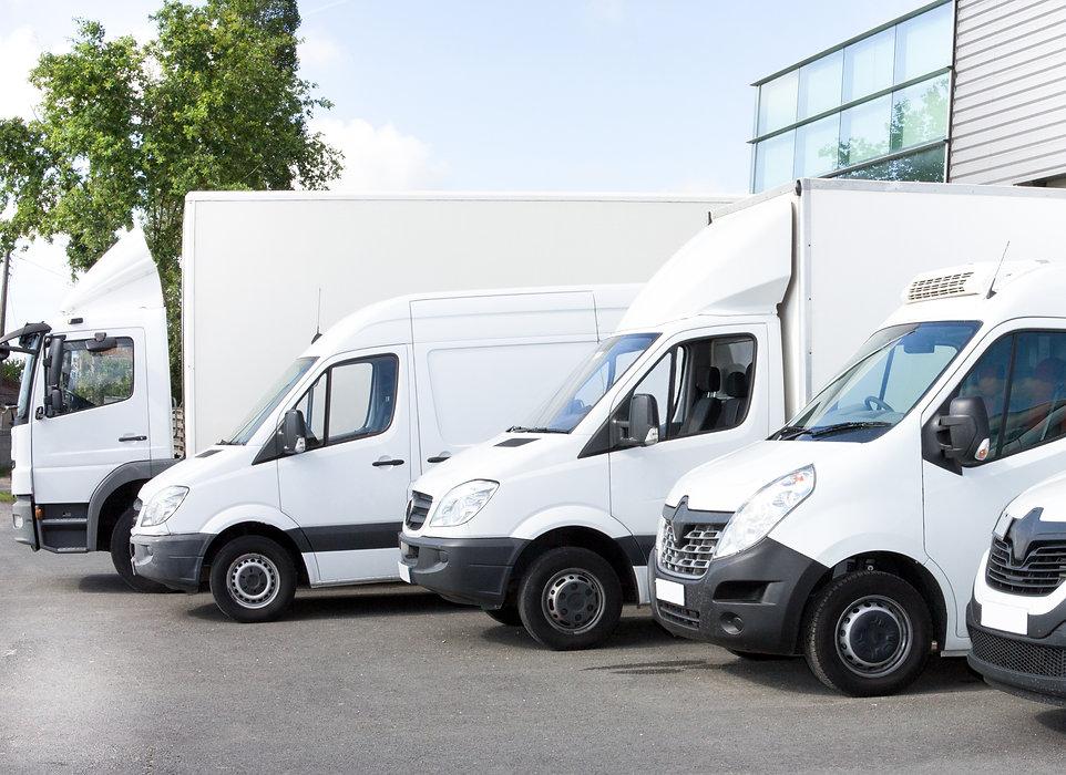 Several cars vans trucks parked in parki