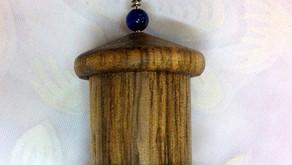 an African Walnut hardwood prayer wheel pendant