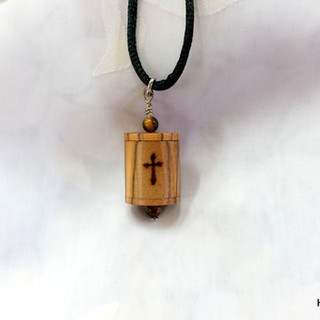 a Christian prayer wheel pendant