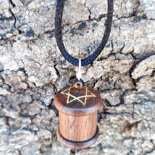 a Shir Lamaalot prayer wheel pendant