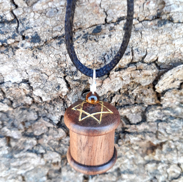 a Shir Lamaalot prayer wheel pendant