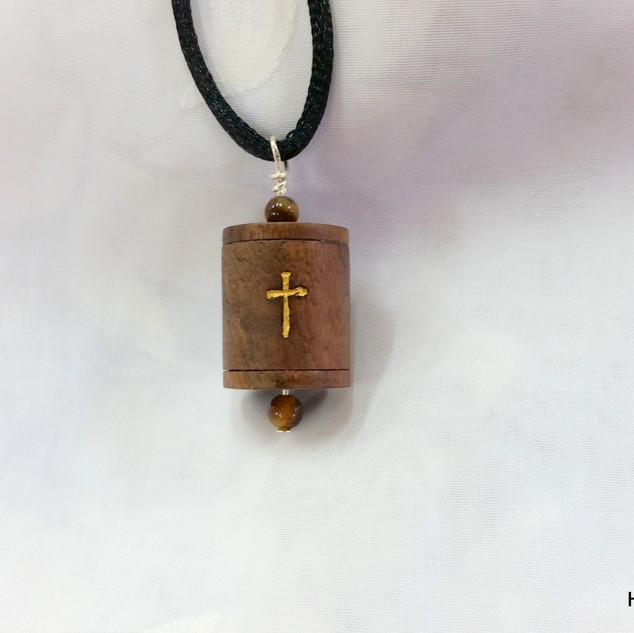 a Walnut Christian prayer wheel pendant