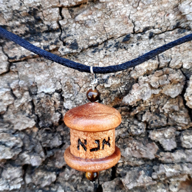 an Ana Bekoach prayer wheel pendant