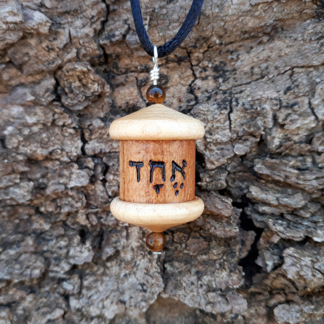 a Shema Israel prayer wheel pendant
