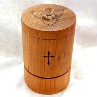 a Cherry tabletop Christian prayer wheel