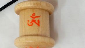 a Maple hardwood Mani mantra prayer wheel pendant