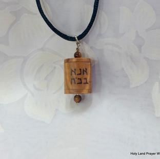 an Ana Bekoach prayer wheel pendant