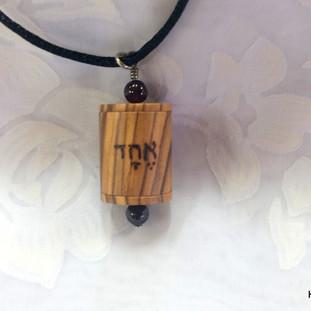 a Shema Israel prayer wheel pendant