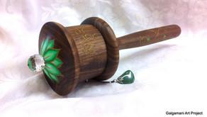 a large Green Tara handheld prayer wheel