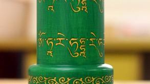 a Green Tara tabletop prayer wheel