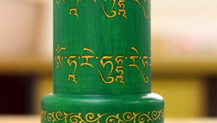 a Green Tara tabletop prayer wheel