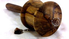 a 100 million Mani mantra African Walnut prayer wheel