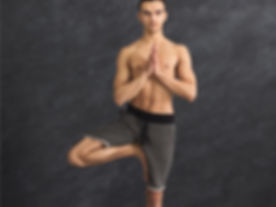 young-man-training-yoga-in-tree-pose-pic