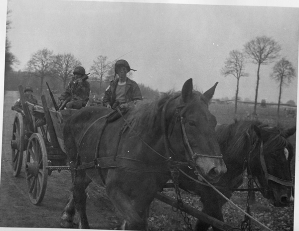 202652 507th Varsity, men with wagon
