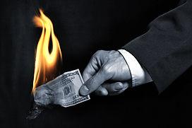 hand holding money on fire.jpg