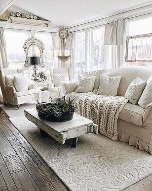 a-white-farmhouse-living-room-with-a-sha