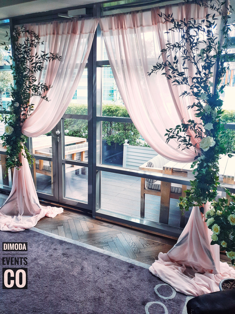 Soft Ruscus and Ivy wedding backdrop