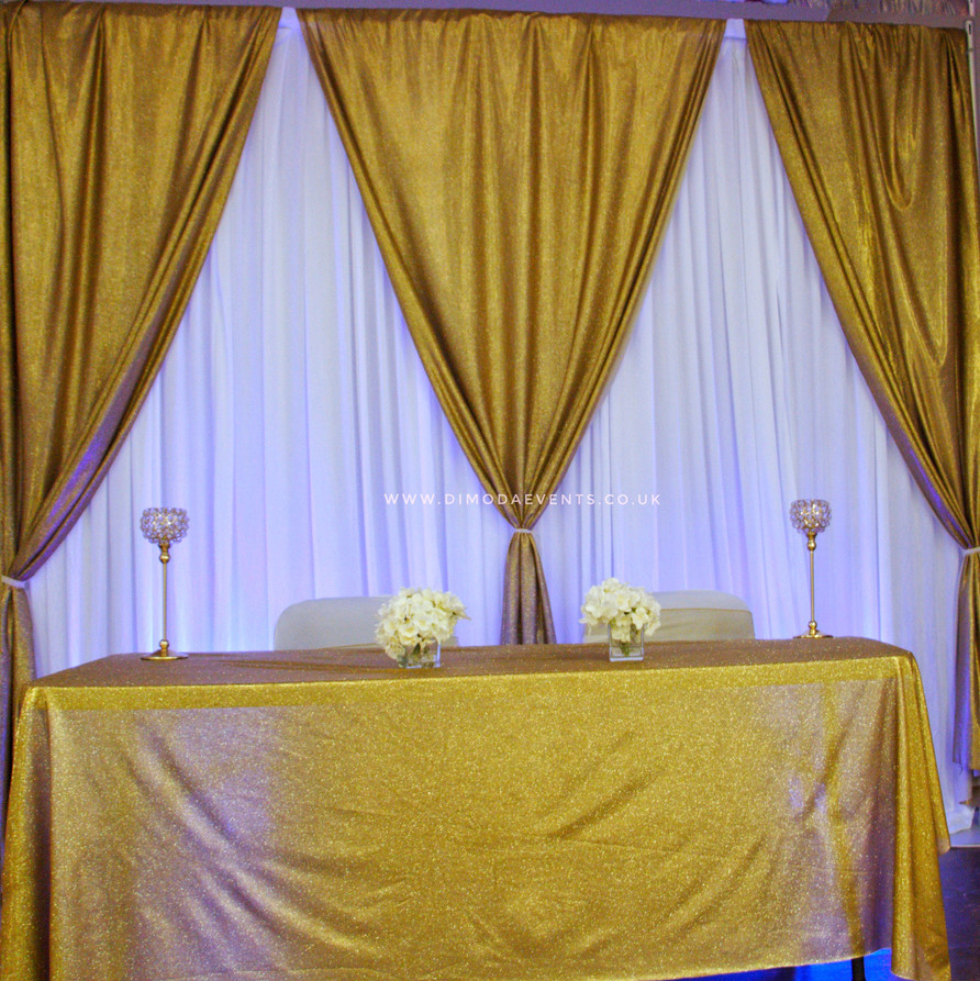 Gold and White Drape Backdrop