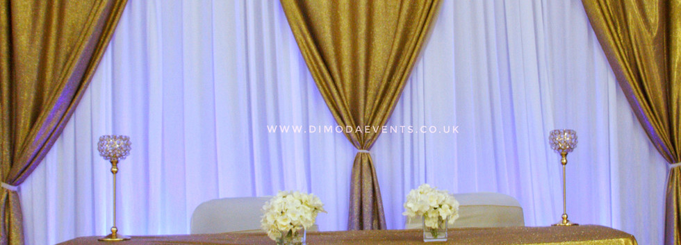 Gold and White Drape Backdrop