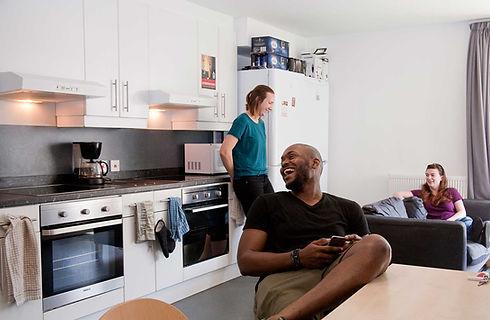 accom-guy-girls-kitchen-iphone.jpg