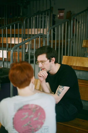Emma and Andrew in discussion about the