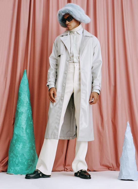 Coat: Stylist's own Shirt: JW Anderson Rollneck: Tod's Trousers: Av Vattev Shoes: Toga Hat: Emma Brewin Eyewear: Port Tanger