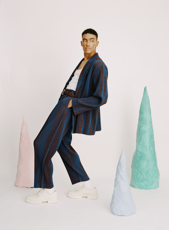 Jacket: Issey Miyake Trousers: Issey Miyake Vest: Les Girls Les Boys Shoes: Camper Belt: Stylist's own Ring: Tom Wood