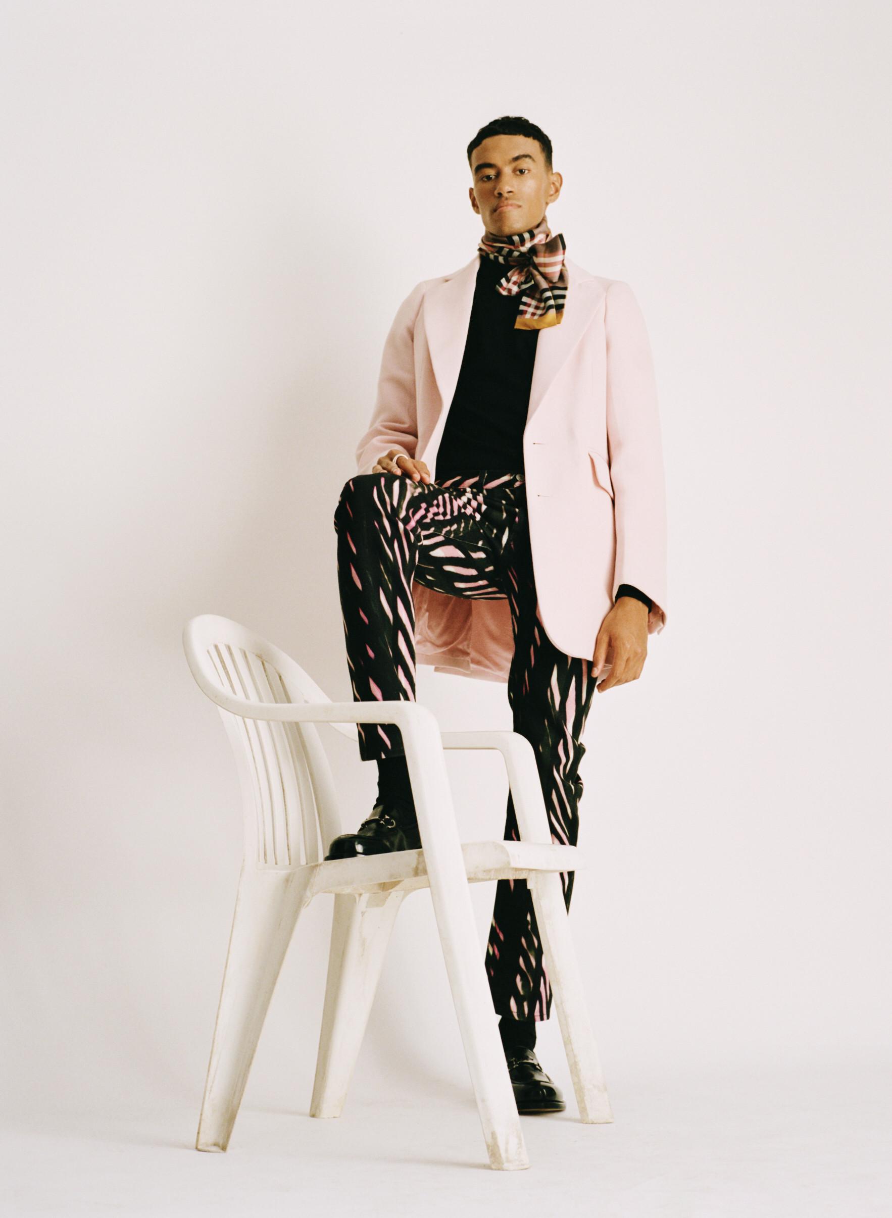 Jacket: Stylist's own Rollneck: Scotch & Soda Trousers: Dries Van Noten Shoes: Salvatore Ferragamo Neck-tie: Stylist's own Ring: Tom Wood