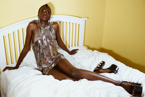 Dress: Rue Agthonis Shoes: Gucci Earrings: Philipee Ferrandis
