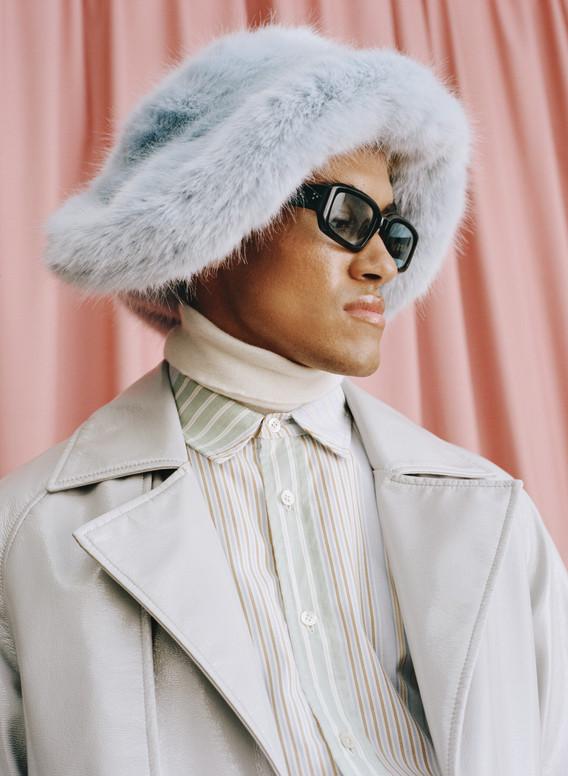 Coat: Stylist's own  Rollneck: Tod's Shirt: JW Anderson Trousers: Av Vattev Shoes: Toga Hat: Emma Brewin Eyewear: Port Tanger