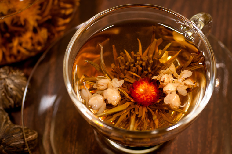 P_ tea with red flower close up in a cup