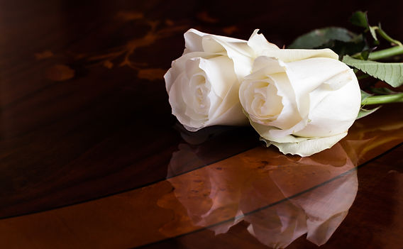 Funeral casket with a rose.jpg