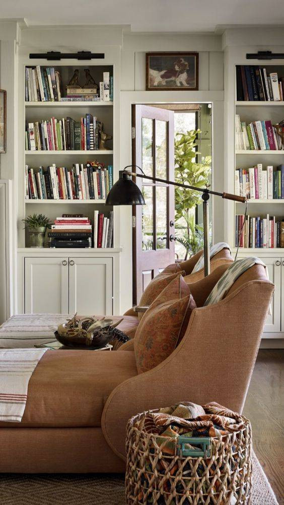 A cozy library with comfortable seating and lots of books.