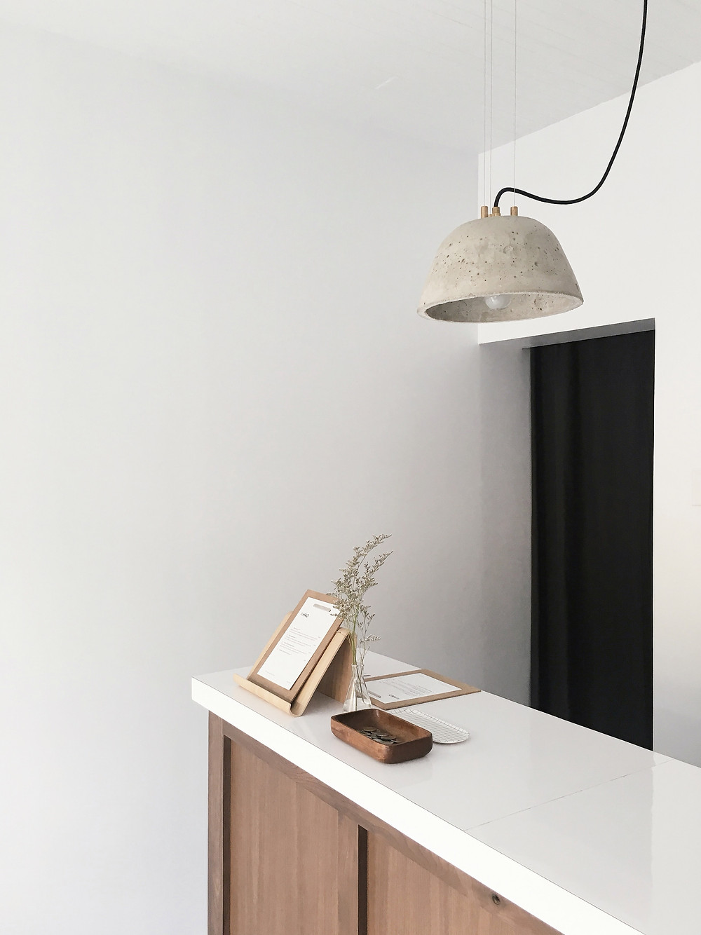 A light shade made from cement.