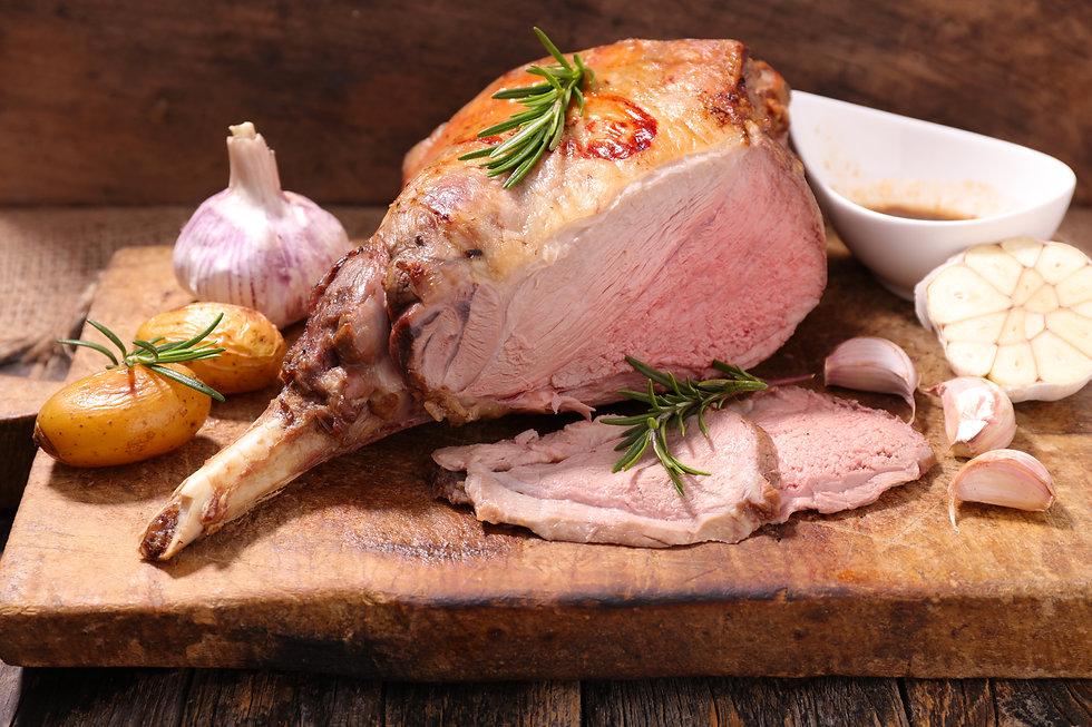 roasted lamb leg on wooden board.jpg