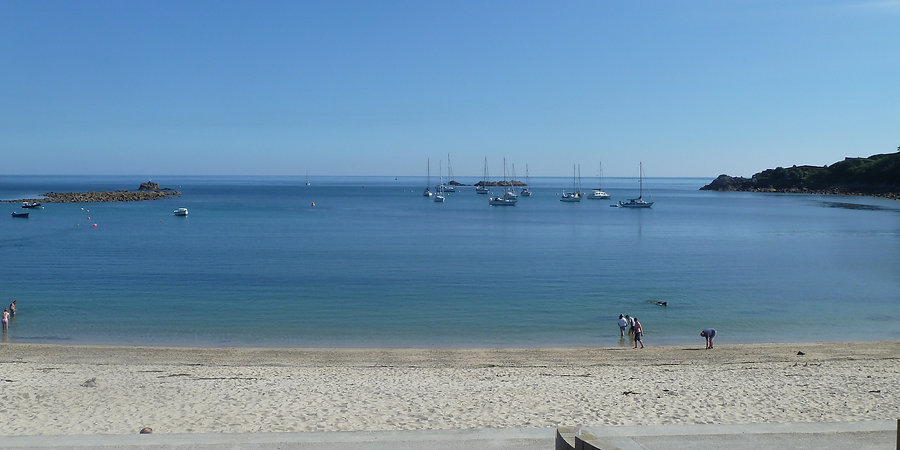Holiday makers on Porthcressa Beach, St Mary's, Isles of Scilly