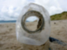 PLASTIC BOTTLE WASHED UP ON A BEACH