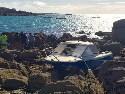 Crashed boat found on rocks, St Mary's, Isles of Scilly