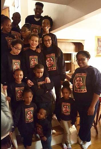 Family wearing the Harriet Tubman Leadership sweatshirts by JLS Art