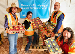 PG&E workers help unload