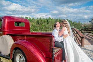 Sowell Farms Barn Wedding.  Bride and Groom on Antique Truck.  Rustic Wedding.  Wedding Photographer.  Pensacola, Florida.