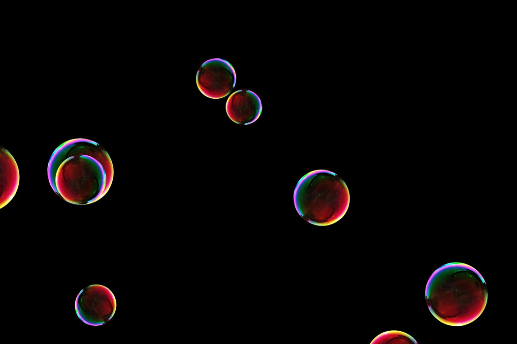 Stunning blowing soap bubbles on black background | Overlay for Photoshop