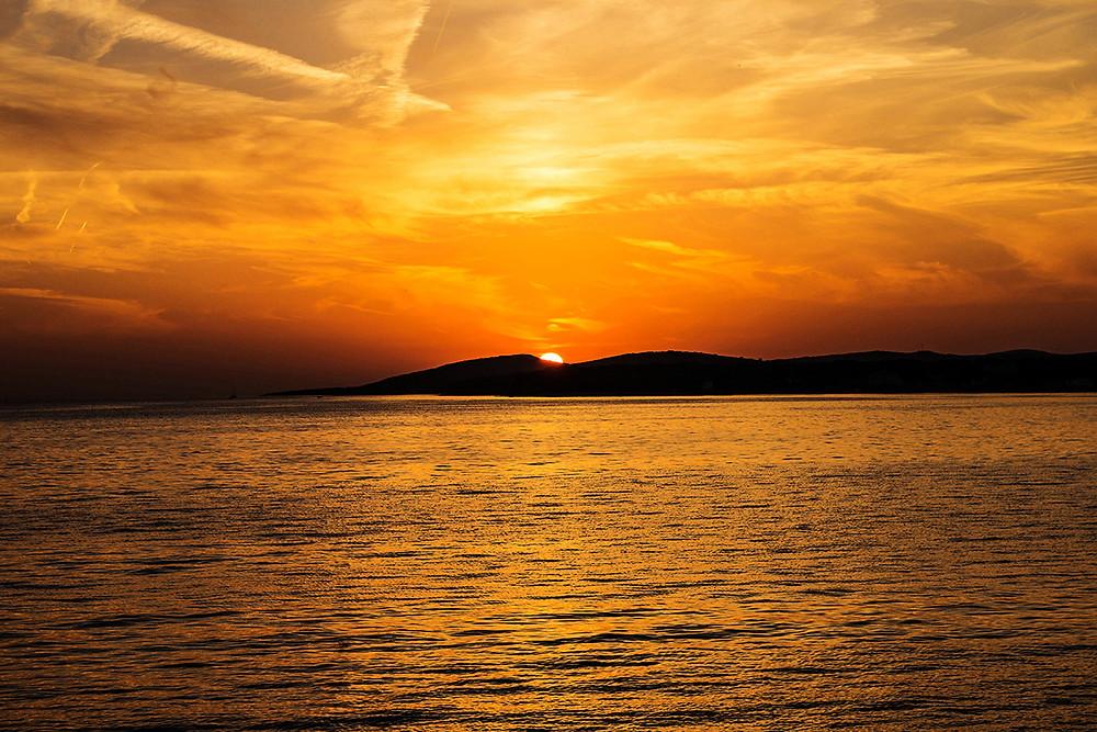 Ocean. Orange Sunset sky California