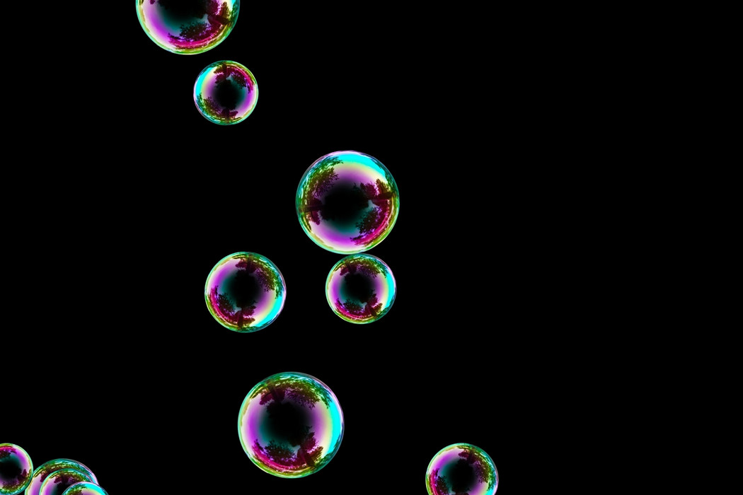 Dreamy blowing soap bubbles on black background | Overlay for Photoshop