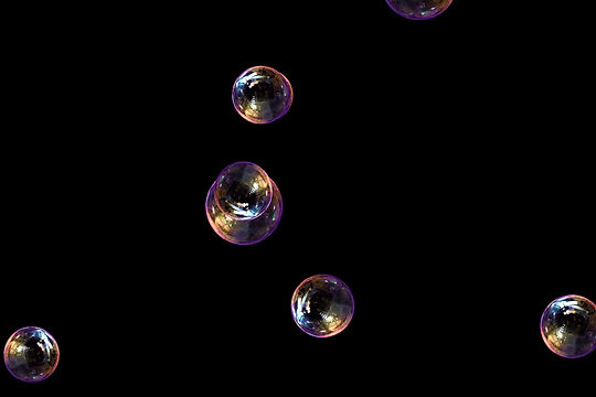 Gorgeous blowing soap bubbles on black background | Overlay for Photoshop