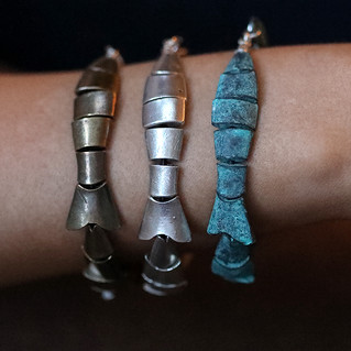 Cast metal and sterling silver.