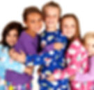 children in winter pajamas hugging each
