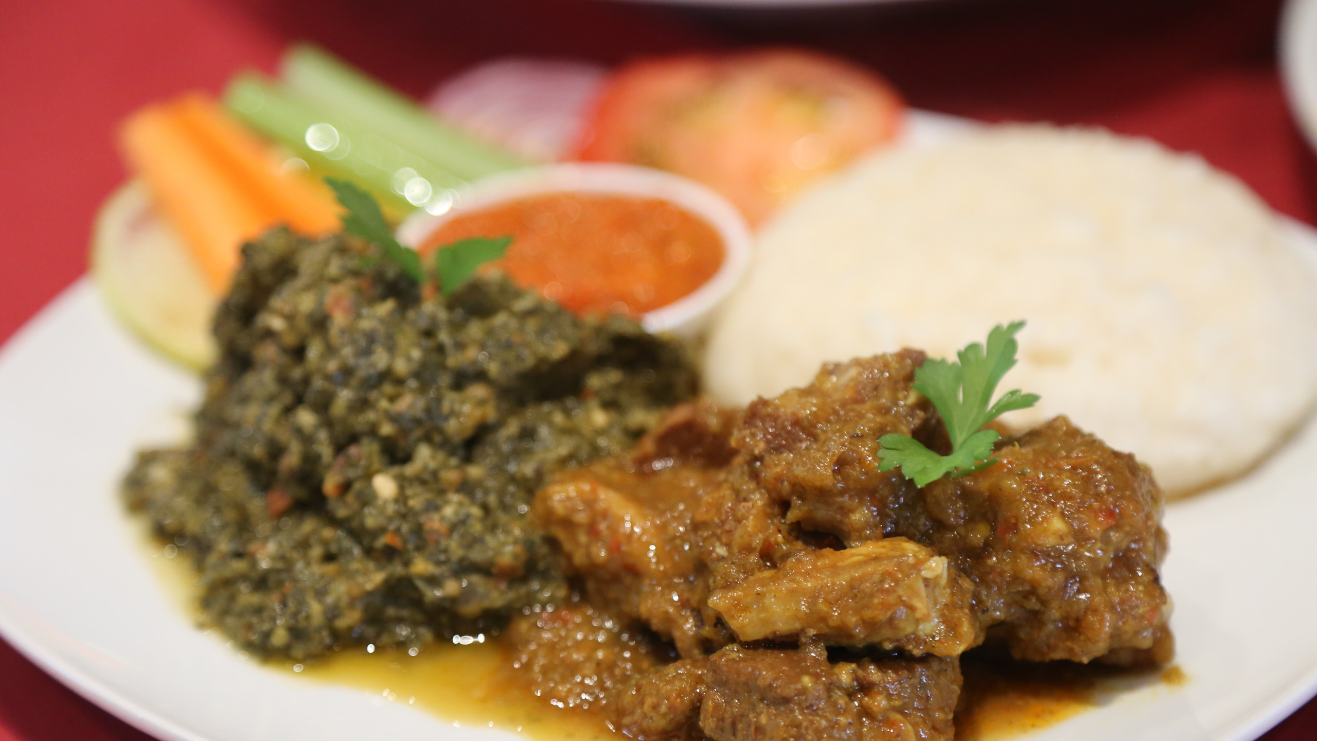 Cassava leaf, goat curry with ugali