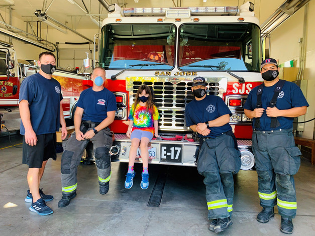 Jamie with Firefighters.jpg